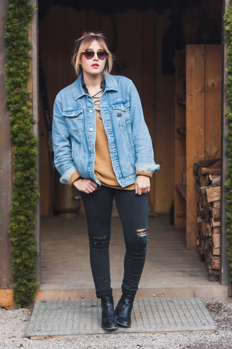 Munich, Germany Augustiner Kellar Beer Hall fashion blogger Bryn Newman of Stone Fox Style wears a layered look featuring Free People from Le Tote and Rag and Bone jeans