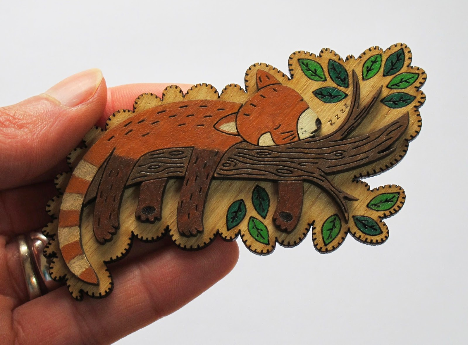 http://folksy.com/items/6192471-Milo-the-Sleeping-Red-Panda-wooden-brooch