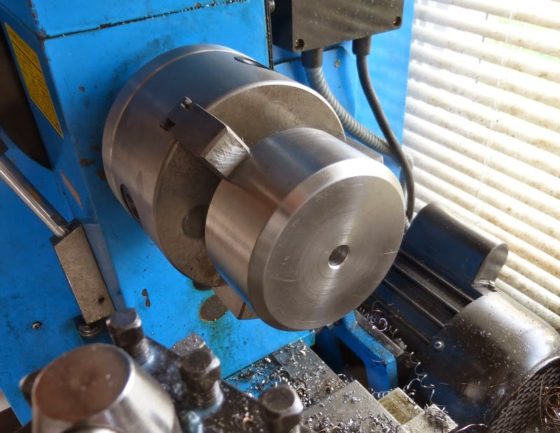 Turning a new steel furnace wheel in the lathe