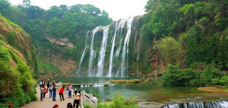 Tourists are Taking Photo of Huangguoshu Waterfall, it is a must-do in your best China tour to Guizhou.