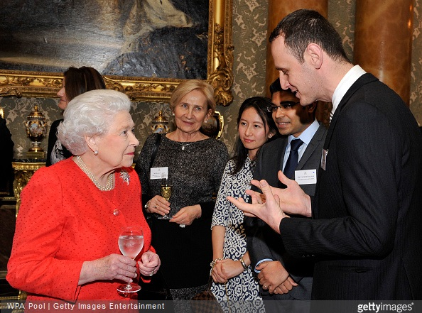 Queen Elizabeth II speaks with young lawyers and law students during a reception to mark the 800th anniversary of the Magna Carta at at Buckingham Place