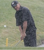 Greg Norman in rain