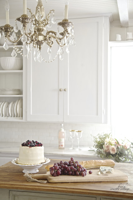 French kitchen with grapes and cheese and cake on the island