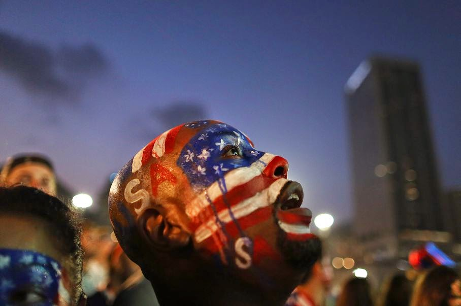 A U.S. soccer fan watches his team's World Cup round of 16 match against Belgium on a live telecast inside the FIFA Fan Fest area on Copacabana beach in Rio de Janeiro, Brazil, Tuesday, July 1, 2014.