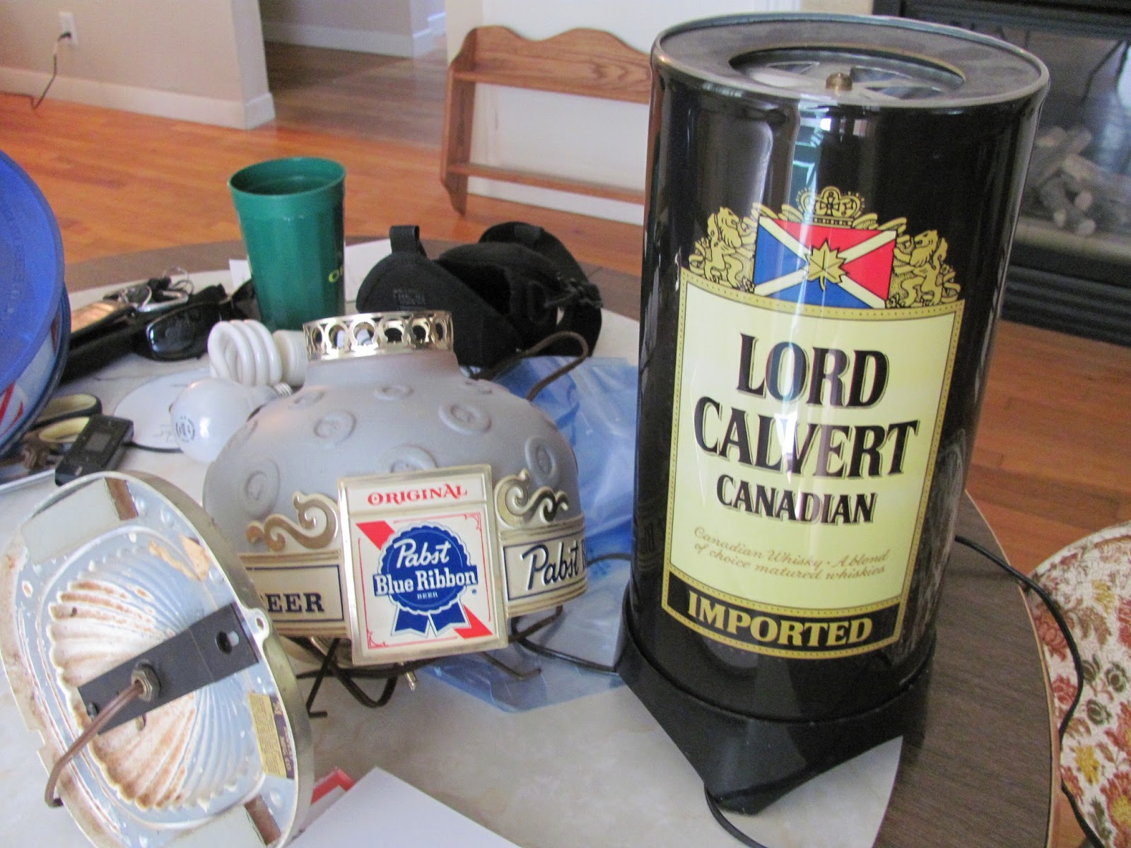 A PBR wall light and a spinning Lord Calvert Canadian Whiskey light