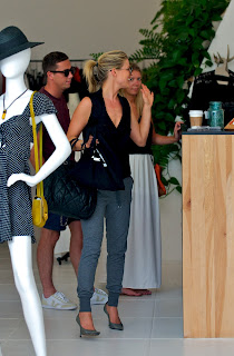 Ali Larter waves to cashier in a store