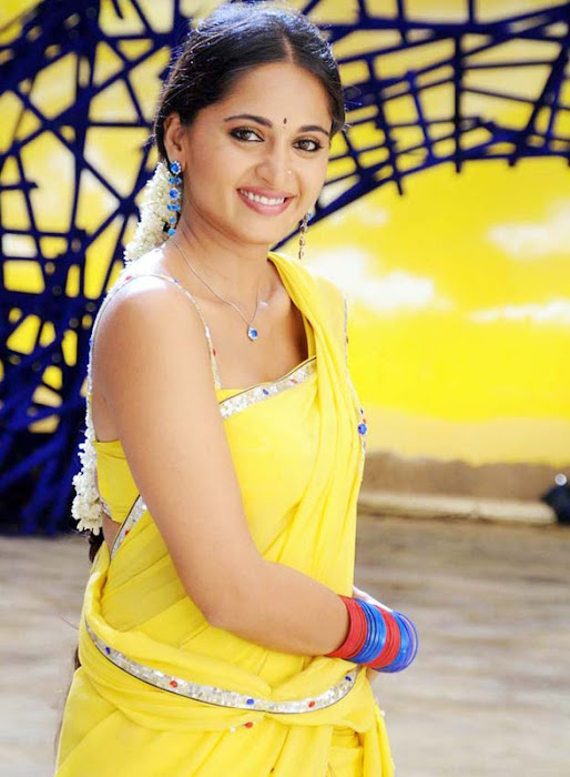 anushka in yellow saree actress pics