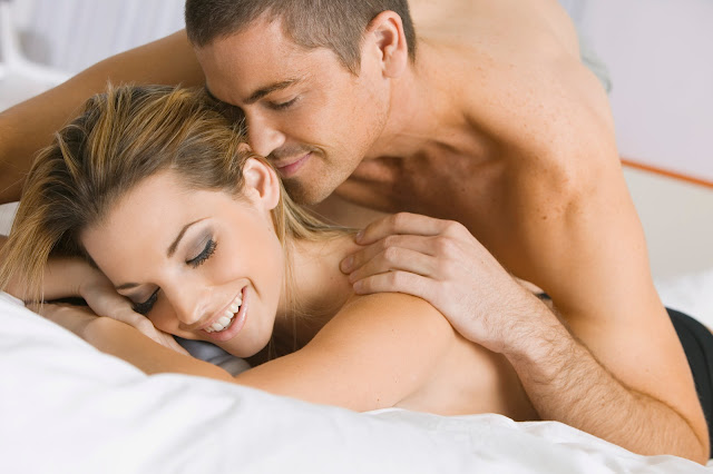 Sexy young couple in bed discussing great sex life.