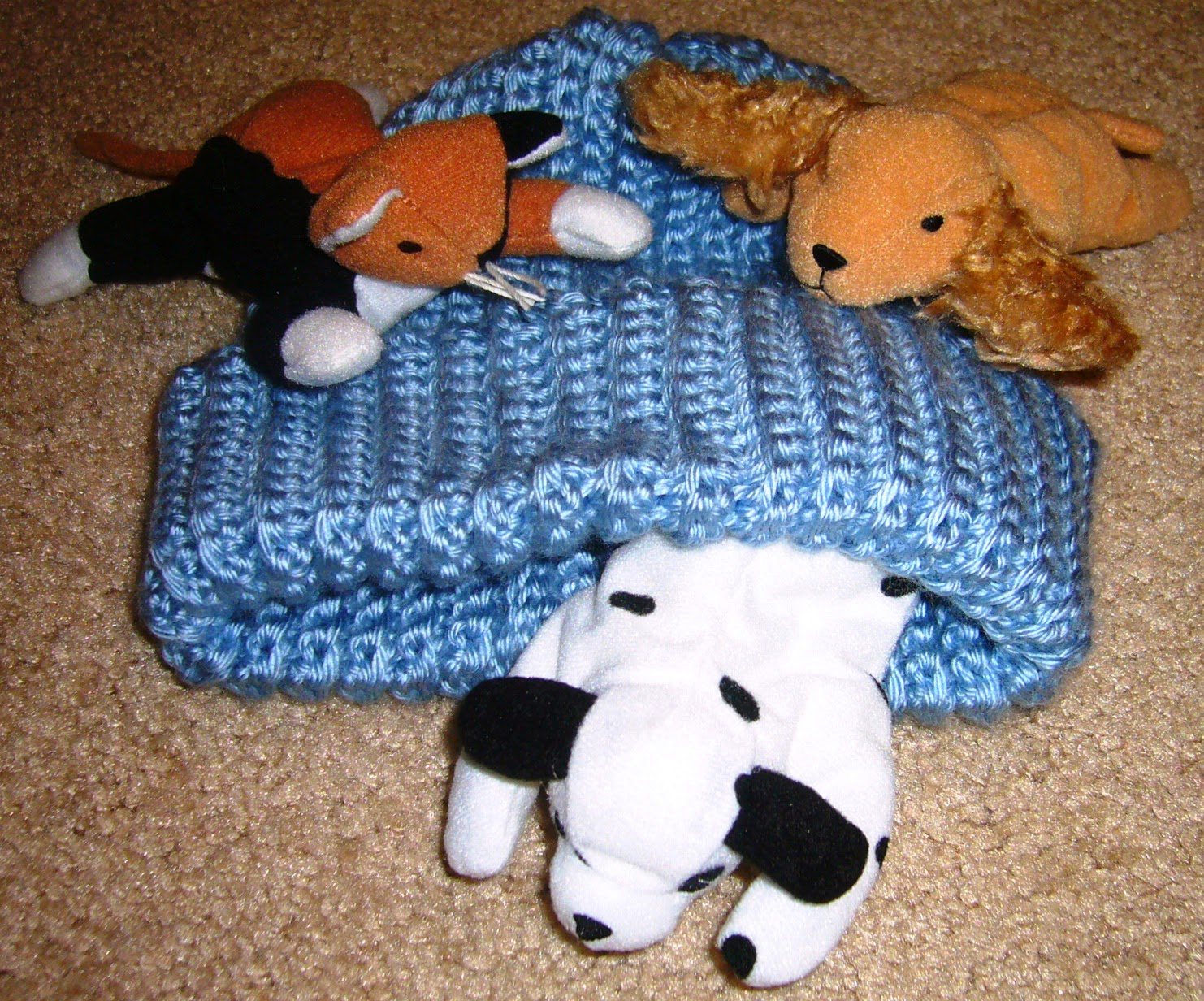 Hand knitted hats and stuffed animals for shoe boxes