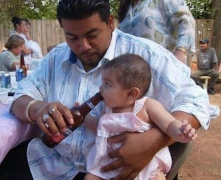 Baby drinking alcohol