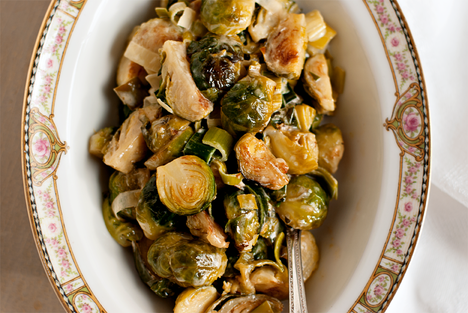 close up of Cream Braised Brussels Sprouts with Leeks in a vintage serving bowl