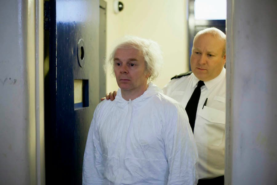 Jason Watkins as Christopher Jefferies and Howard Coggins as Custody Officer in The Lost Honour of Christopher Jefferies