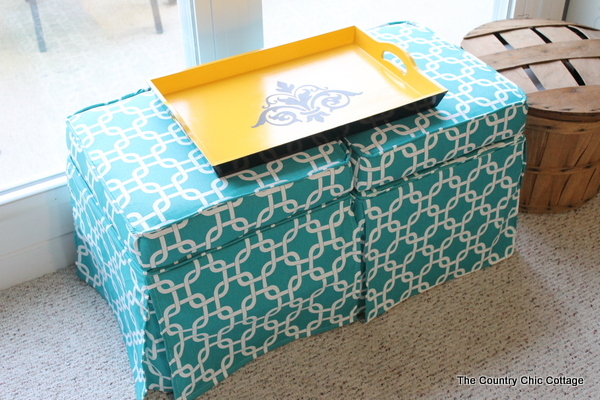 DIY Upholstered Coffee Table -- use reupholstered ottomans and a tray as a coffee table.  Easy to do it yourself from thrift store finds!