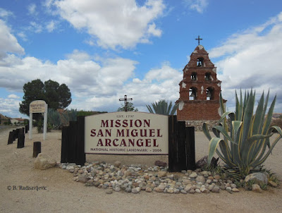 Mission San Miguel Sign with Belfry in Background, © B. Radisavljevic