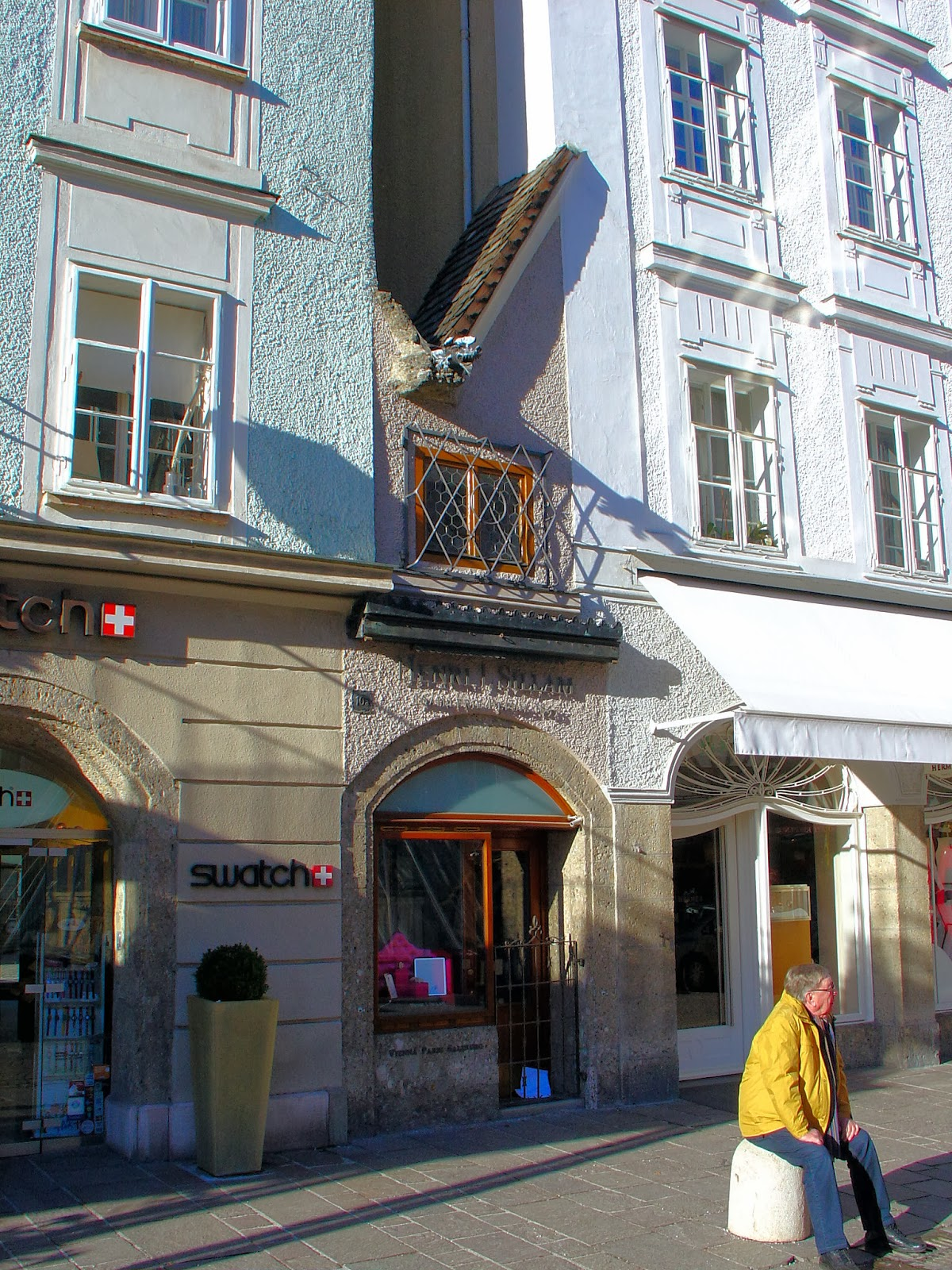 The smallest house in Salzburg can be found in the Alter Market or Old Market square tucked between the Domplatz and Getreidegasse shopping street also the location of Mozart's birthplace.