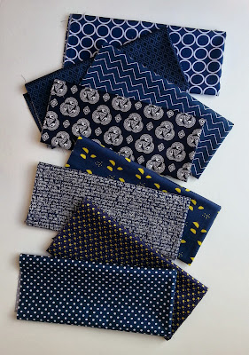 navy fabrics arranged in a cascading row