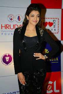 Actress Kajal Agarwal Latest Pictures in Stylish Black Dress at CCL Charity Dinner 15