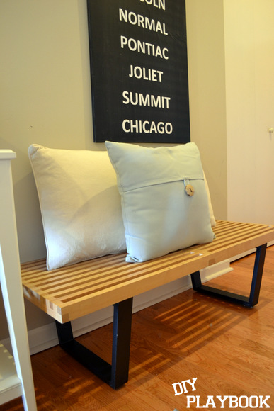 Wooden bench with pillows in front hall: Design Your Entryway | DIY Playbook