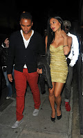 Nicole Scherzinger looks super hot in a gold low cut dress