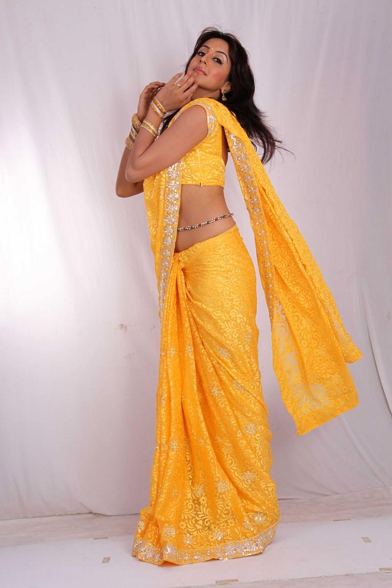 Sanjana in hot yellow saree