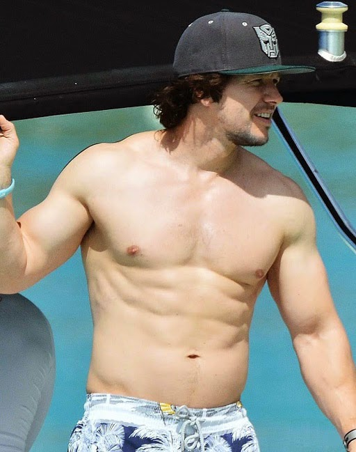 Shirtless Mark Wahlberg shows off his beefy, muscled body while vacationing in Barbados