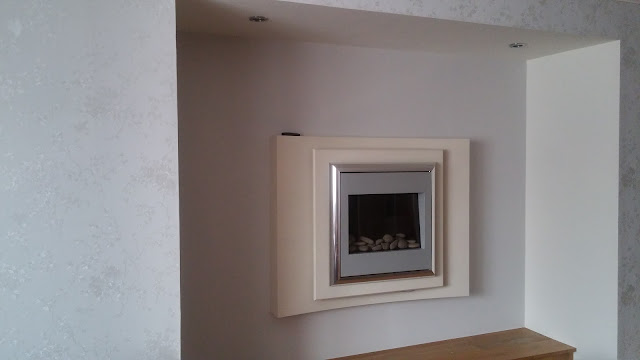 wallpapering and fire place