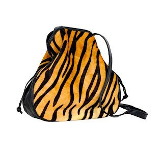 Vintage 1980's tiger print pony hair Halston bag with black leather trim.