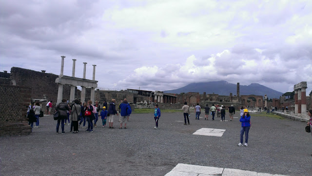 Pompeii forum - open space with people milling around