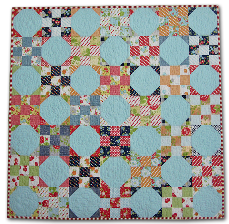colorful modern patchwork handmade quilt by the sewing chick