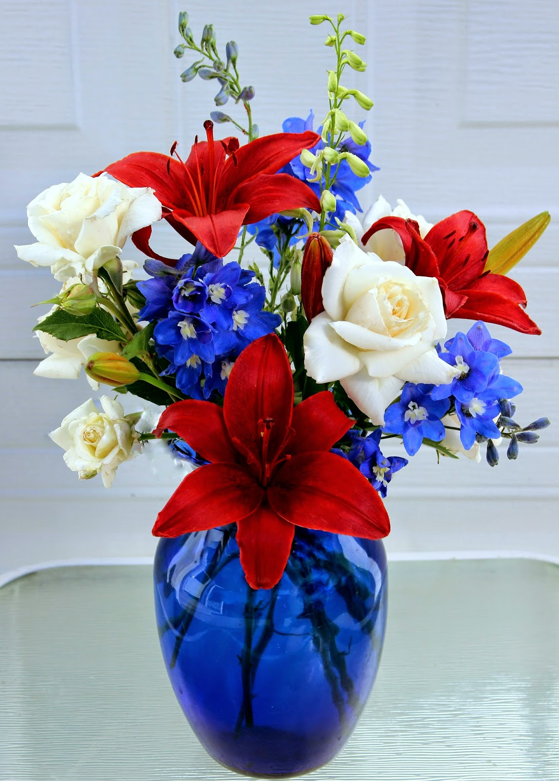 Floral arrangements red white and blue for the 4th of for Red white blue flower arrangements