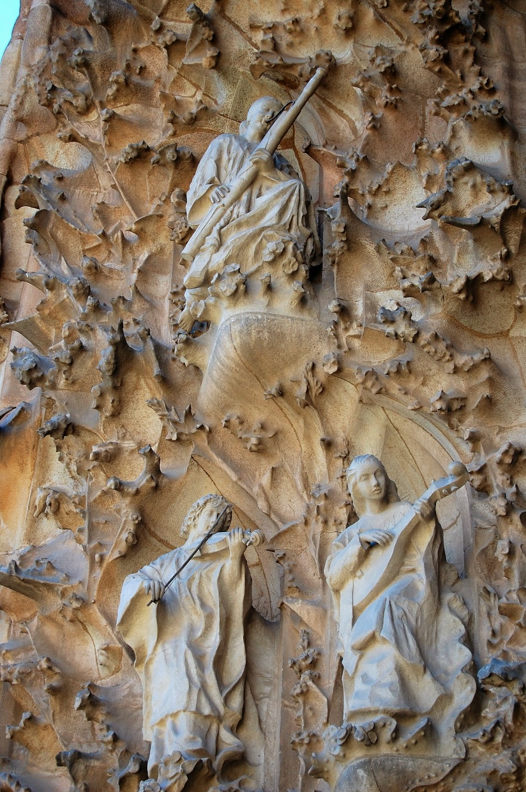 Carvings of bassoonist, violinist, and lutist on Nativity Facade