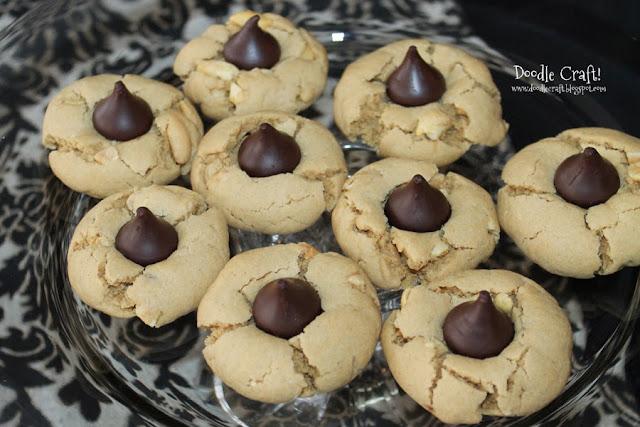 http://www.doodlecraftblog.com/2013/11/peanut-butter-kisses-cookies.html