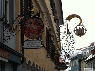 clash of cultures, doner kebap sign next to an old traditional restaurant sign