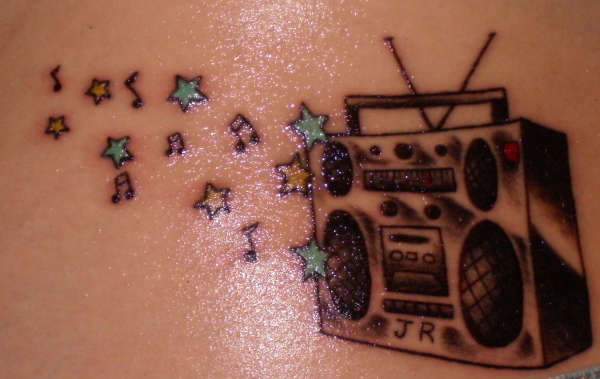 star tattoos with names in them. music notes tattoo. music note