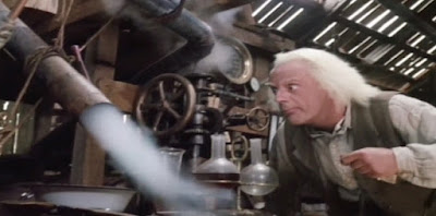 regreso volver al futuro emmett brown doc Christopher Lloyd robert zemeckis crazy scientist film chemistry flask