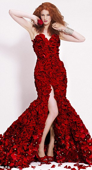 The petals from 1,000 of Naomi red roses cover the entire body, running down to the floor and the entire look was completed with a pair of rose petal covered stiletto shoes.