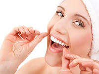 flossing, tali gigi, kesehatan gigi, tips kesehatan mulut