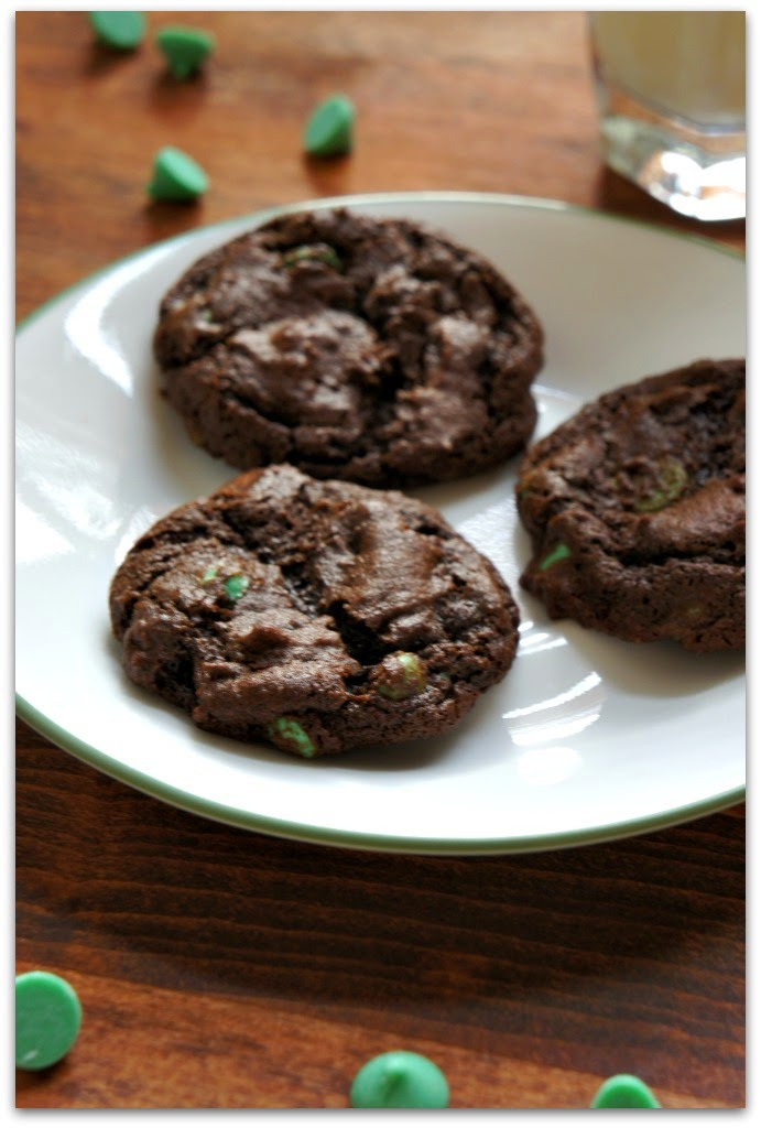 These soft baked, chewy chocolate mint chip cookies are ultra chocolate-y and have the perfect amount of mint flavor from the festive green mint chips.  They taste like the cookie form of a an Andes mint.
