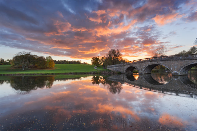 Sunset at Blenheim park reflected in the River Glyme in Oxfordshire by Martyn Ferry Photography