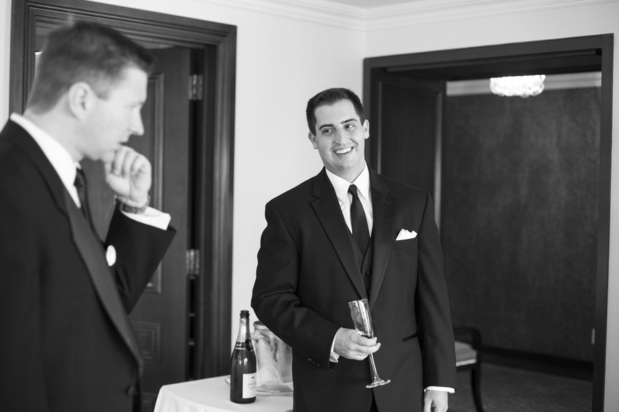 candid lifestyle portrait of happy smiling groom