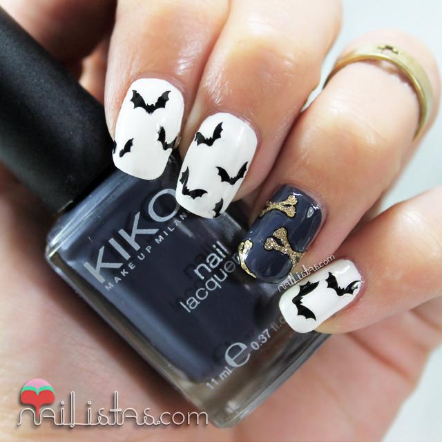 Uñas decoradas con murciélagos y huesos