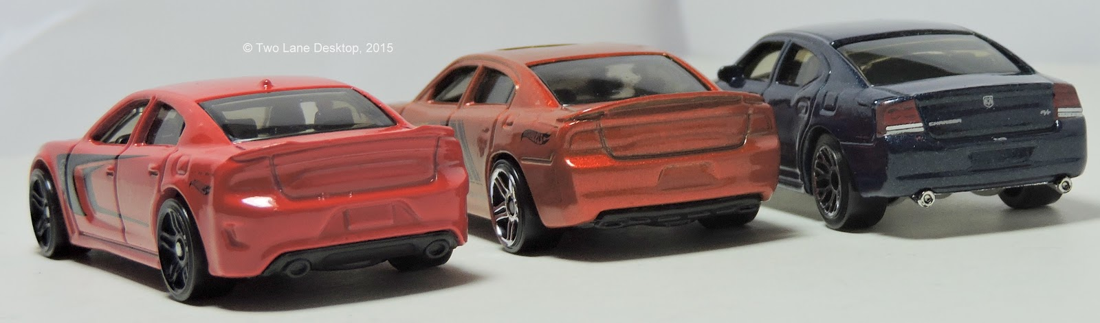 Charger SRT Hellcat, alongside Hot Wheels 2011 Charger R/T and