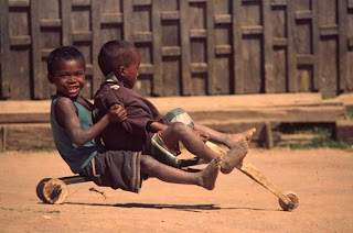 funny photo: African children with homemade bicycle