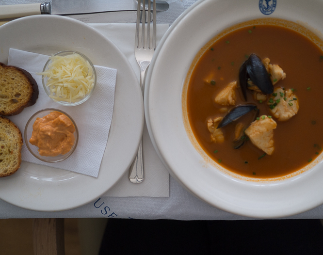 Eating bouillabaisse soup at the Seaside Boarding House, Burton Bradstock Dorset