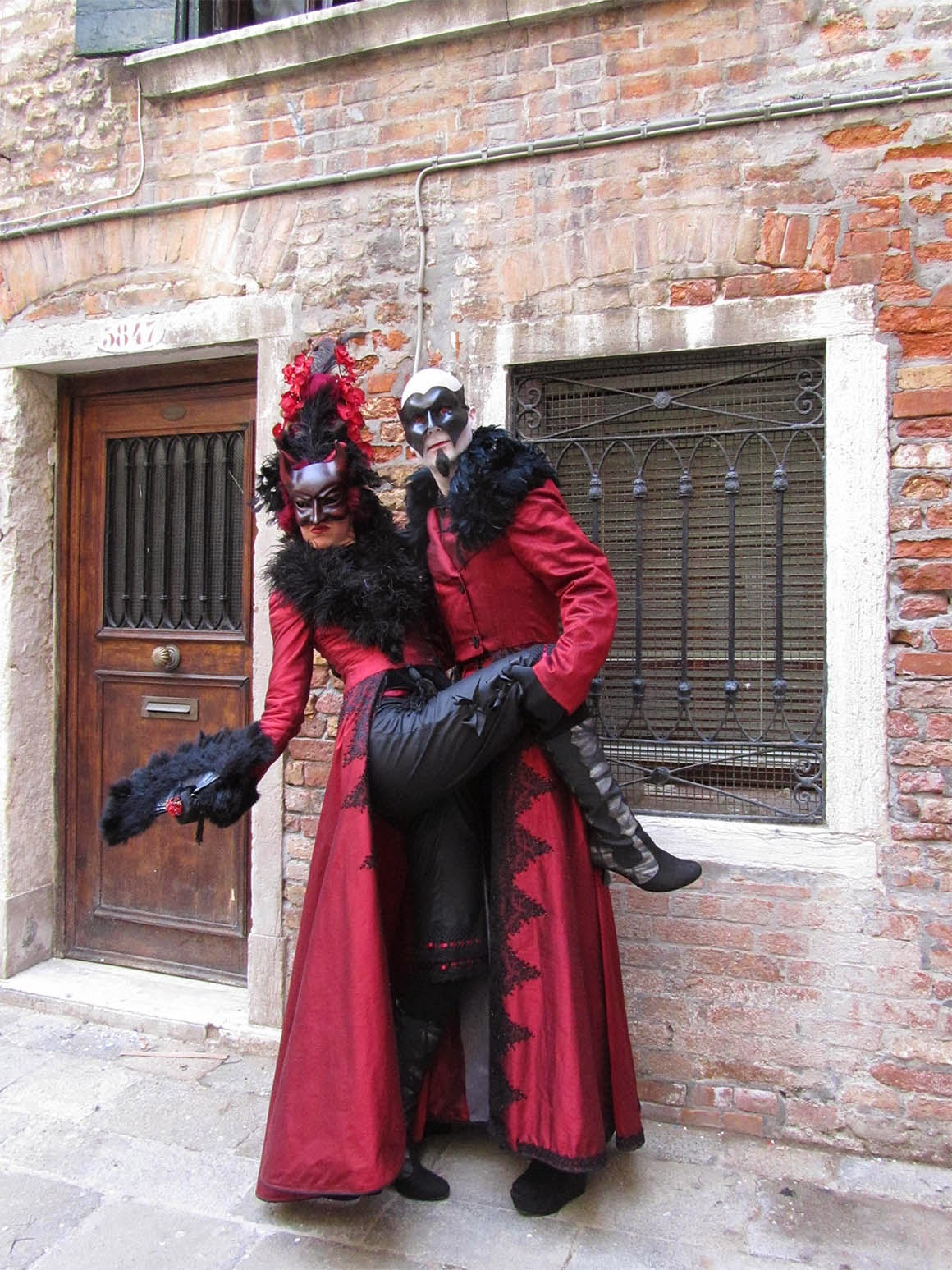 two devils in costume