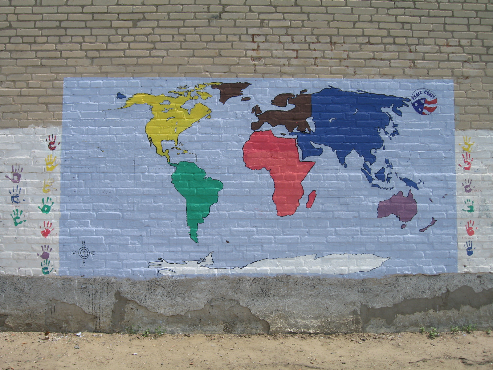 our map of the world with handprints from the students and pcvs who helped us make it happen