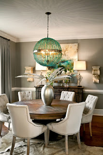 Unique Chandelier in Dining Room with Wooden Round Dining Tables and Unique Chairs on Animal Skin Rug