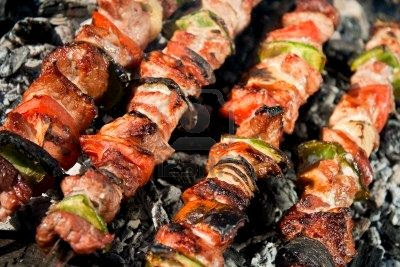 5752302 barbecue with meat skewers barbecue with delicious grilled meat on grill Your Wedding...Bringing the Destination Home