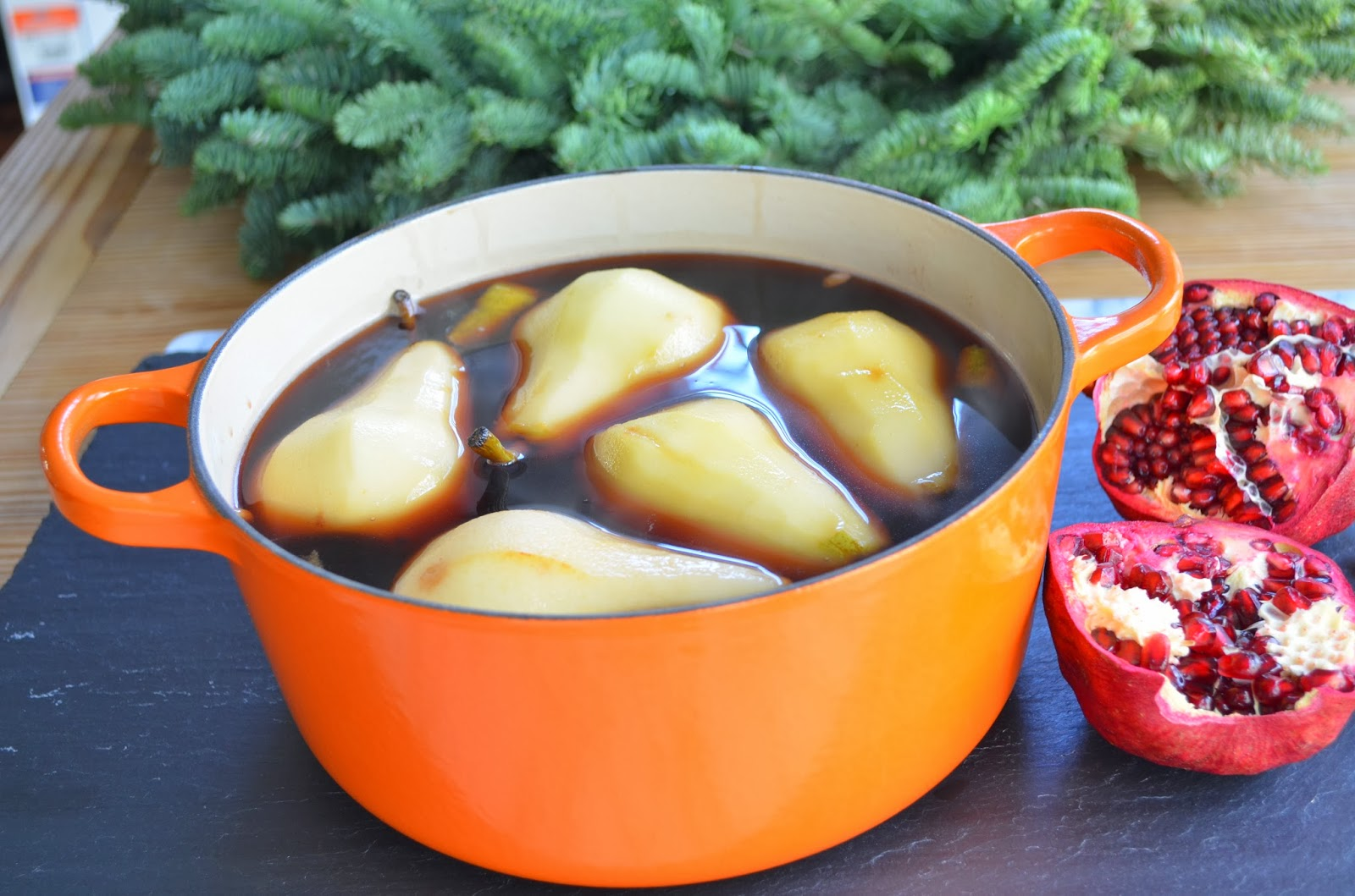 Poached pears with creme Anglaise - poaching pears.