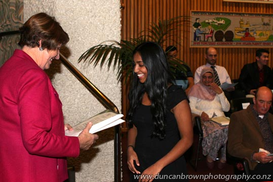Deputy-mayor Cynthia Bowers presents New Zealand Citizenship to Jeriel Sajan, from Hastings photograph